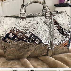 Louis Vuitton silver duffle